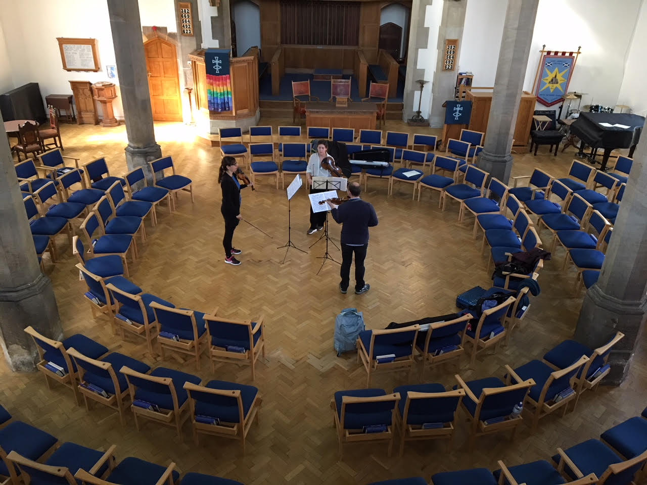 Music in the Round rehearsal at St Andrew's URC for their concert on 27 September, 2018 with the chairs in the round
